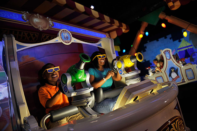 Toy Story Midway Mania attraction photo.  Photo of Walt Disney World attraction, but California attraction is essentially the same.  Photo copyright Disney.